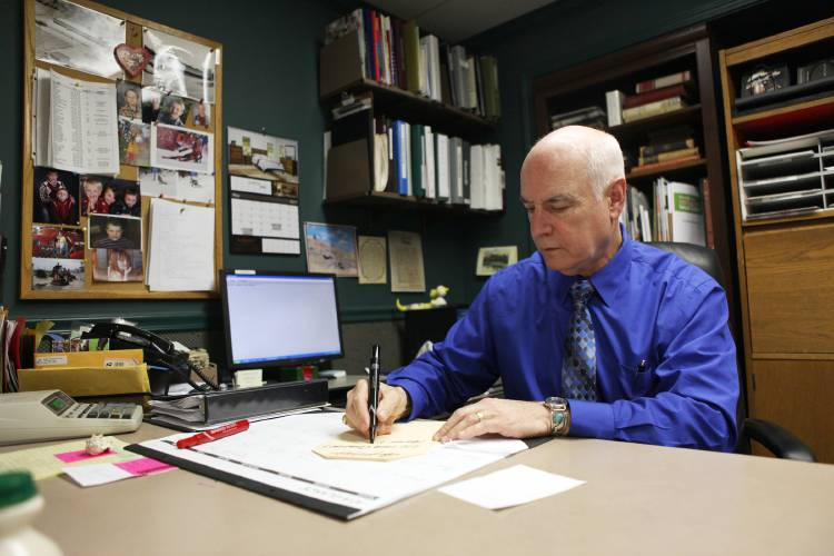 Bridgmanu0027s Furniture Owner Steve Rutledge Writes Furniture Tags In His  Office On Friday, May 12, 2017, In Lebanon, N.H. Rutledge Is Retiring And  Selling His ...