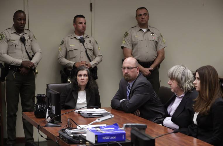 Louise Anna Turpin, left, with her attorney Jeff Moore, and her husband  David Allen Turpin, second from right, appears in court for their  arraignment in ...