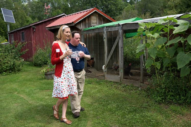 ... of White River Junction, left, and Brett Wilson, of Hanover, right,  walk the grounds of Sunrise Farm in Enfield, N.H., during an open house for  ...
