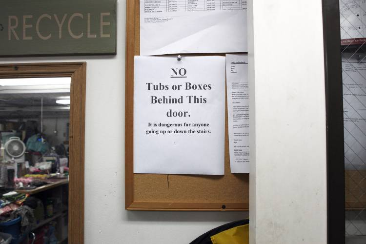 A Sign Of Caution For Employees In The Sorting Room At Listen Community  Services On Saturday, June 17, 2017, In Lebanon, N.H. (Valley News    Jovelle Tamayo) ...