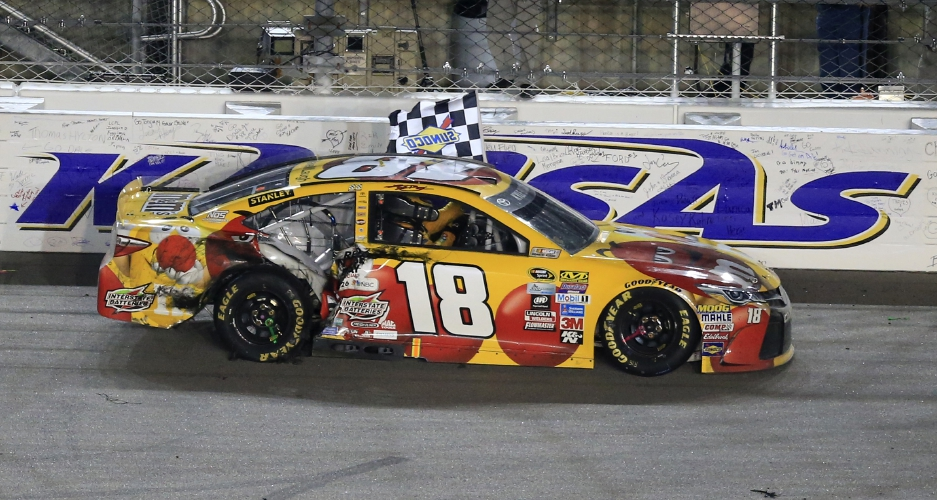 (18) celebrates with the checkered flag after winning a Sprint Cup ...