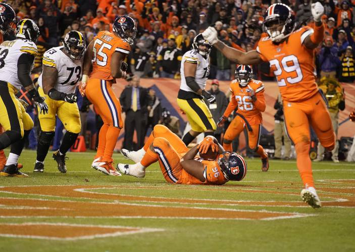 1c378c59ff6 Denver Broncos defensive end Shelby Harris (96) intercepts a pass in the  end zone against the Pittsburgh Steelers during the second half of an NFL  football ...