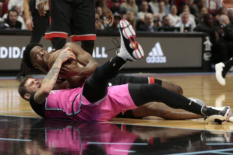 a3494d1a141 Miami Heat guard Tyler Johnson (8) and Toronto Raptors forward OG Anunoby  (3) fight for control of the ball during the second half of an NBA  basketball game ...