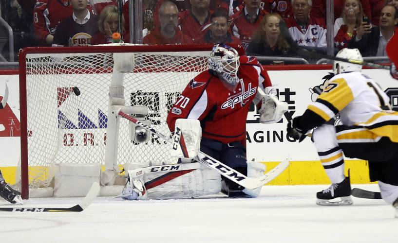 f8d9bea6de6 Pittsburgh Penguins right wing Bryan Rust (17) scores a goal past Washington  Capitals goalie Braden Holtby (70) during the second period of Game 7 in an  NHL ...