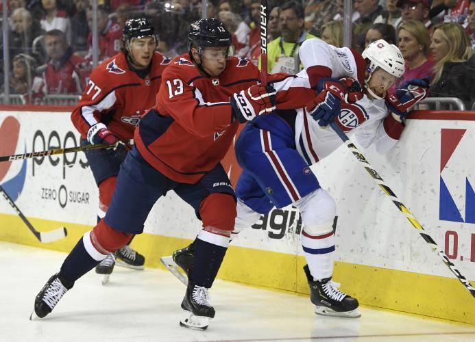 79e5c065224 Washington Capitals left wing Jakub Vrana (13), of the Czech Republic,  pushes Montreal Canadiens defenseman Brett Kulak (17) up against the board  as ...