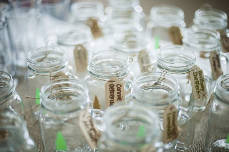 This May 17 2017 Photo Provided By Marissa Demercurio Shows Custom Printed Mason Jars With Handwritten Wooded Carved And Decorated Nametags In Boulder