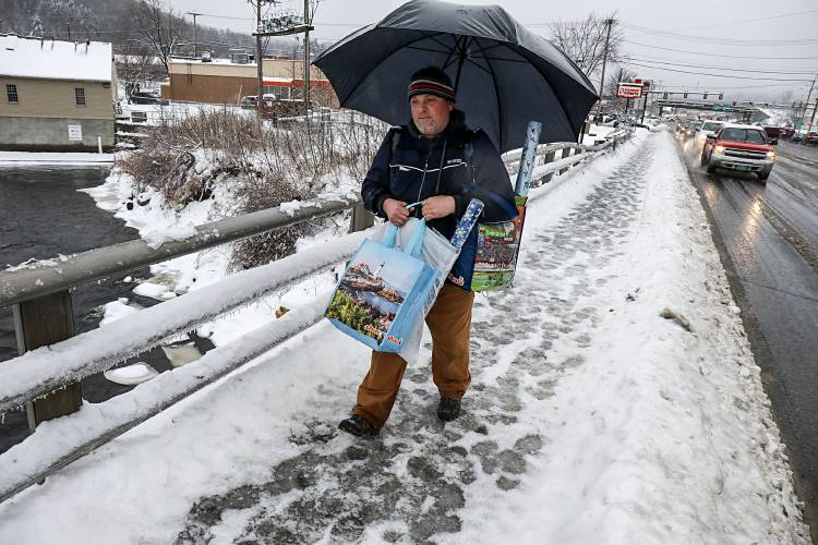 Eric Matson Of West Lebanon N H Walks In The Freezing Rain With Christmas Presents For His Children On Saturday Dec 23 2017 On Route 12a In West