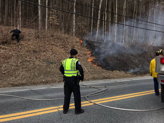 Valley News - Firefighters battle brush fire near Route 14