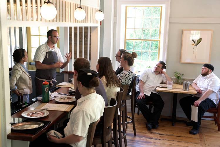 Chef Peter Varkonyi Educates His Staff On The Menu During A Meal And Meeting Before Opeing For Evening At Wild Roots In Royalton Vt Thursday