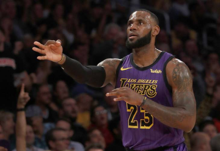 556644066544 The Los Angeles Lakers  LeBron James celebrates a 3-point shot against the  Portland Trailblazers in the second quarter on Wednesday
