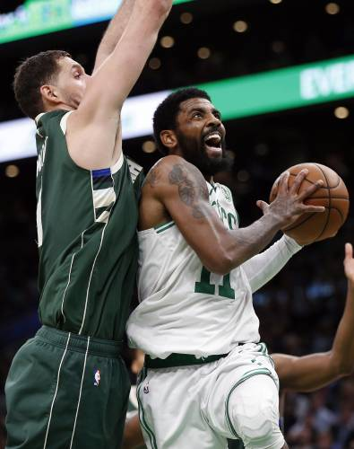 de091d79303 Boston Celtics  Kyrie Irving (11) shoots against Milwaukee Bucks  Nikola  Mirotic during the second half of Game 4 of a second-round NBA basketball  playoff ...