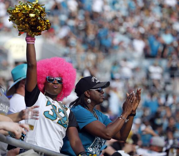 6e27587f531 Jacksonville Jaguars fans cheer during the first half of an NFL football  game against the Los Angeles Rams, Sunday, Oct. 15, 2017, in Jacksonville,  Fla.