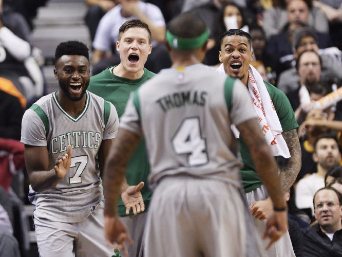 Boston Celtics Players Celebrate A Basket By Guard Isaiah Thomas 4 During The Second Half Of An NBA Basketball Game Against Toronto Raptors On Tuesday