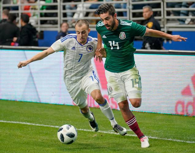 Darko Todorovic For Possession During The Second Half Of An International Friendly Soccer Match Wednesday Jan   In San Antonio Mexico