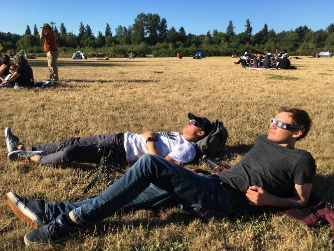 Jonathan Moric Left And Finn Both Of Vancouver Get Ready To Watch The Eclipse Monday Aug 21 2017 In A Park M Ore