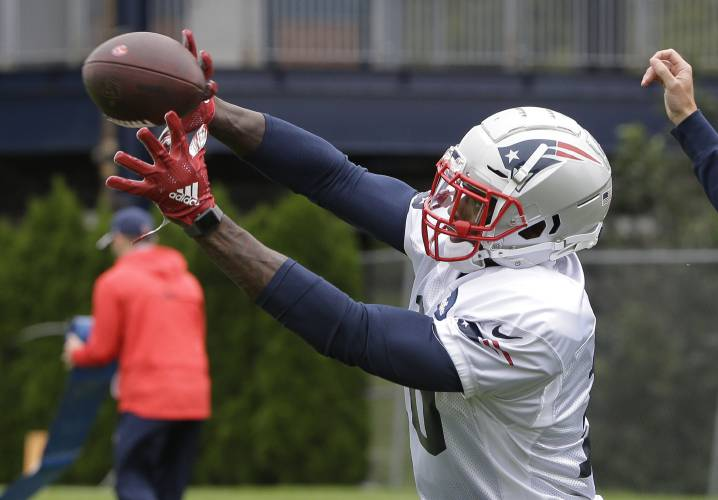 New England Patriots wide receiver Josh Gordon catches the ball during an  NFL football practice 21fa3cec6