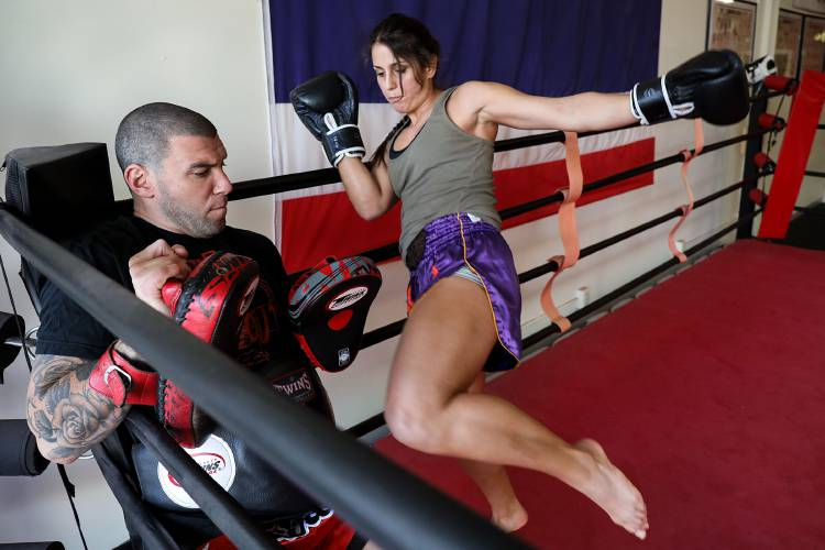 Mark Klemm Left Of Lebanon N H Holds Pads For A Kicking Maria Kritikos A Fighter With Baan Muay Thai Academy On Sunday Nov