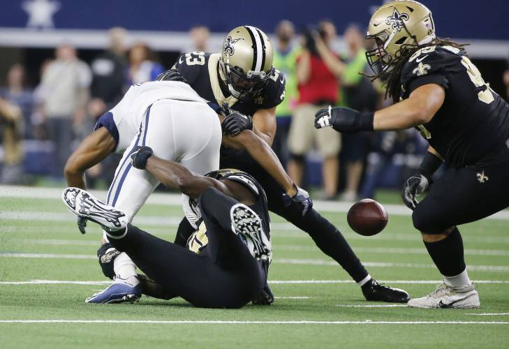 dad81cfc7 Dallas Cowboys wide receiver Amari Cooper, left, fumbles as he is hit by New  Orleans Saints cornerback Marshon Lattimore (23) in the first half of an NFL  ...