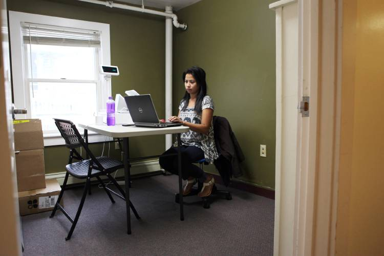 ... Works On A New Point Of Sale Systems From A Temporary Training Space At  The Current Listen Office Building In Lebanon, N.H., On June 16, 2017.