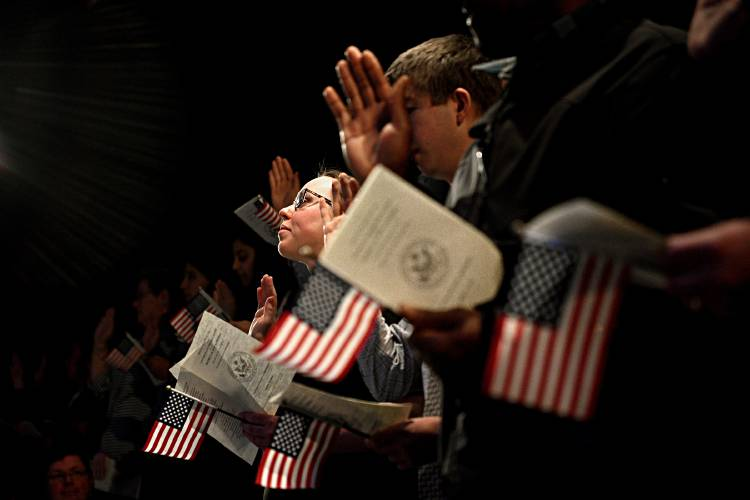Valley News - Immigrants Become Naturalized Citizens in Hanover High