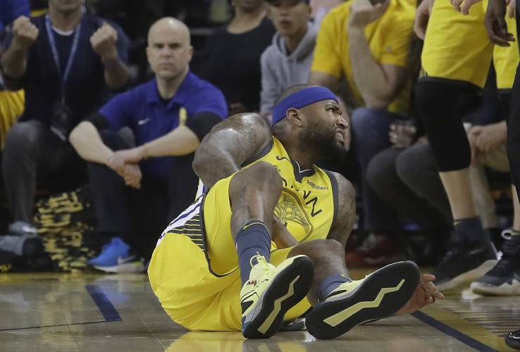 e2fac992e Golden State Warriors center DeMarcus Cousins reacts after falling to the  floor during the first half of Game 2 of a first-round NBA basketball  playoff ...