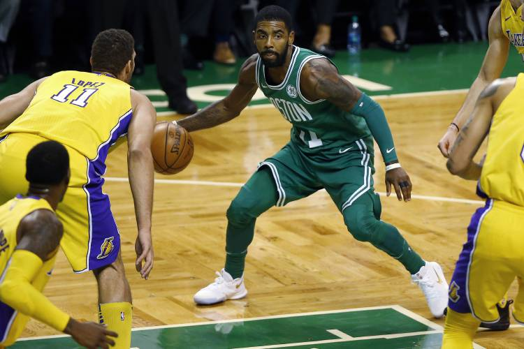 f37c097f8 Boston Celtics  Kyrie Irving looks for an opening past Los Angeles Lakers   Brook Lopez during the first quarter of an NBA basketball game in Boston ...