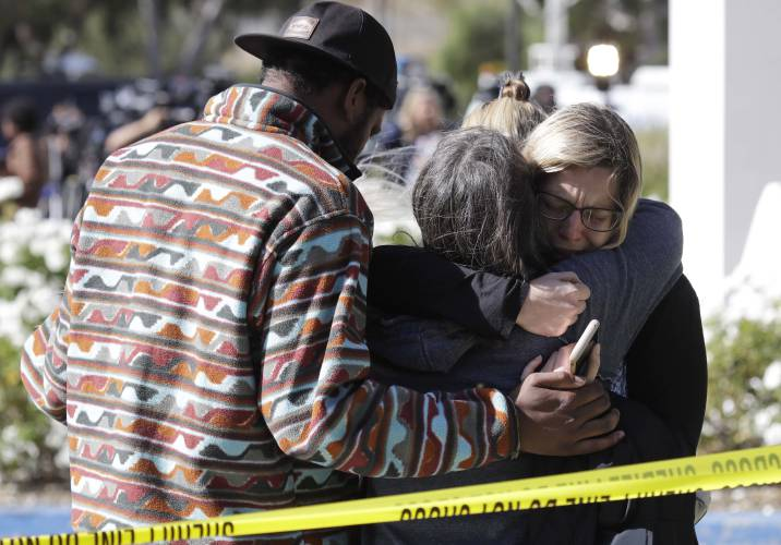 b2243d03bab Mourners embrace outside of the Thousand Oaks Teen Center