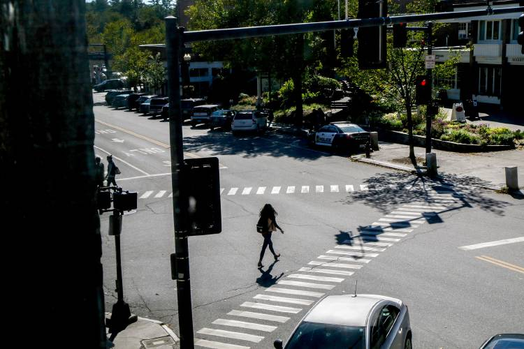 a377a8ec05 A woman crosses the intersection of South Main and Lebanon Streets in  Hanover