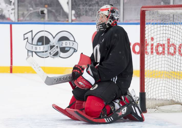 Ottawa Senators goalie Craig Anderson kneels in his crease as he watches drills  during an outdoor practice Friday Dec. 15 dba06e88a
