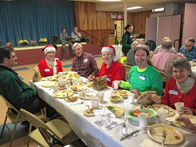 scenes from past christmas day dinners at sacred heart church in lebanon courtesy photographs