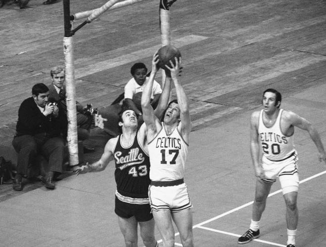 ee9f484d44e Boston Celtics  John Havlicek (17) grabs rebound away from Seattle  Supersonics  Barry Clemens in second period of their National Basketball  Association ...