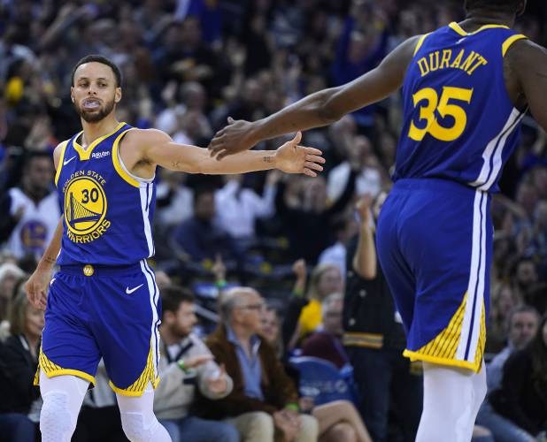 350d5bb13e67 Golden State Warriors  Kevin Durant (35) high-fives Stephen Curry (30) after  Curry made a 3-point shot against the Cleveland Cavaliers during the second  ...