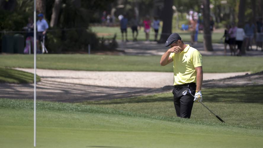 Valley news resurgent poulter in lead at rbc heritage his shot out into the bunker on the second green from the rough during the third round of the rbc heritage golf tournament in hilton head island publicscrutiny Images