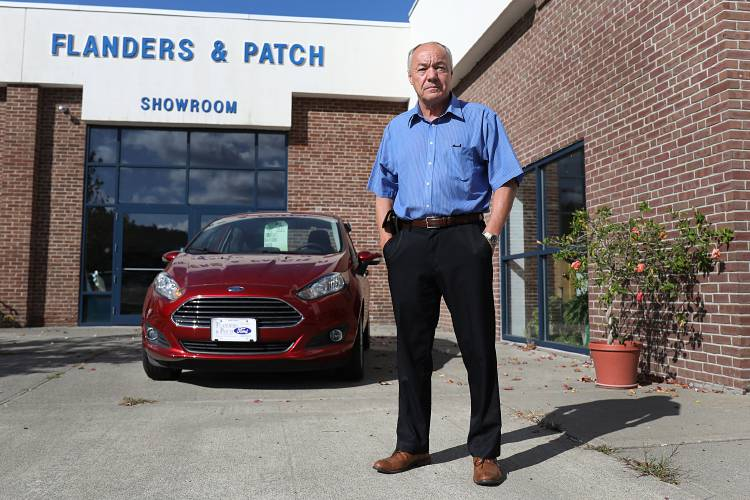 tom thayer owner of flanders and patch ford stands outside the showroom on thursday sept 28 2017 at the dealership in lebanon nh thayer is selling