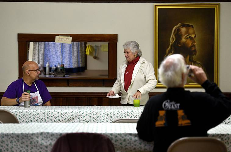 pastor earl dionne left and barbara loyer a church member host a free breakfast at the rachel s harlow united methodist church on dec - Rachels Kitchen