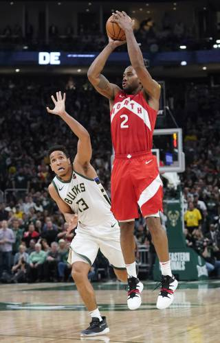 6541802af Toronto Raptors  Kawhi Leonard shoots in front of Milwaukee Bucks  Malcolm  Brogdon during the second half of Game 5 of the NBA Eastern Conference  basketball ...