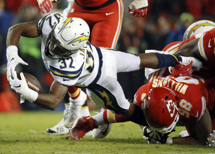 Los Angeles Chargers running back Justin Jackson (32) is tackled by Kansas  City Chiefs tackle Xavier Williams (98) during the first half of an NFL  football ... 4bb45b310