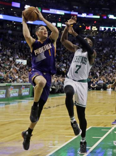 26c3e24f3 Phoenix Suns guard Devin Booker (1) goes up for a shot against Boston  Celtics forward Jaylen Brown (7) during the first quarter of an NBA  basketball game